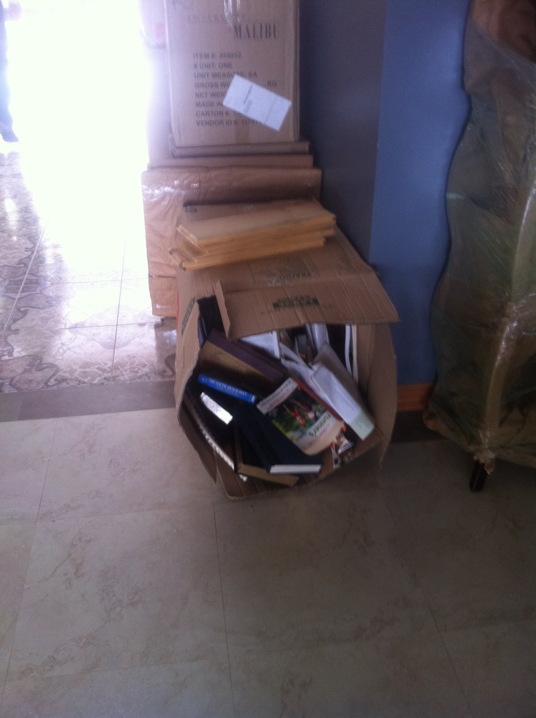 Boxes had been opened by the inspectors and their contents were spilling out by the time they reached the house.