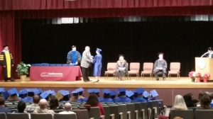 "The announcer read, ""Receiving a certificate in Outdoor Leadership and a certificate in Wilderness Medicine, Marcia Cecilia Boyle."""