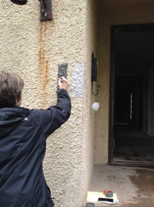 The contractor paints a sample of the new color scheme over the well-worn exterior of our lovely, old home.