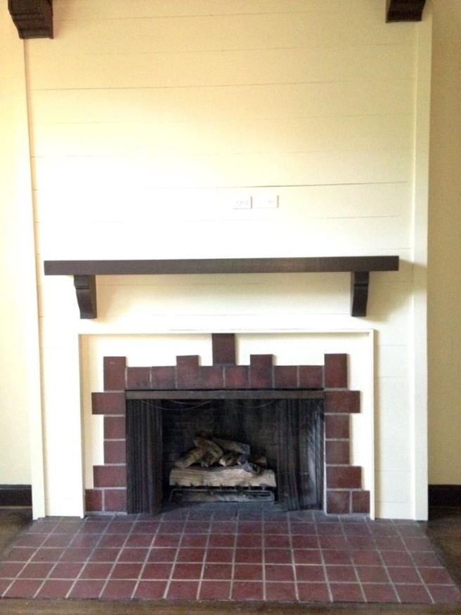 Shiplap and a mantle update the fireplace.