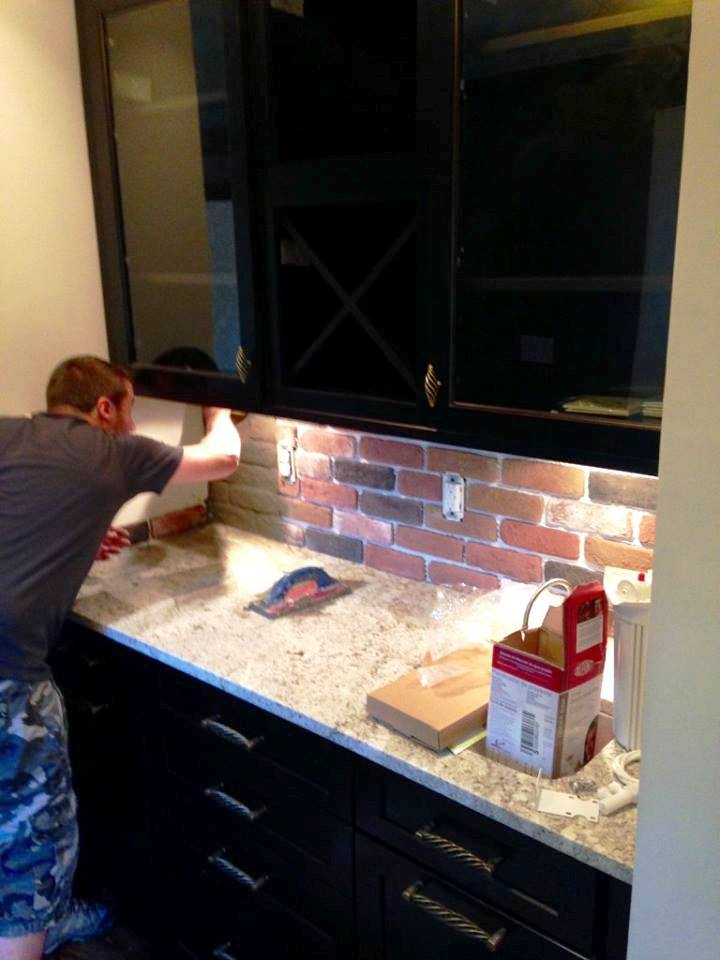 Brick veneer found for a steal on Craig's List created the back splash for the butler's pantry.