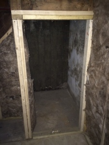 The wine cellar was an unfinished space under the stairs 'before'