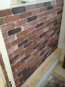 Brick veneer was added to the outside wall of the basement landing.