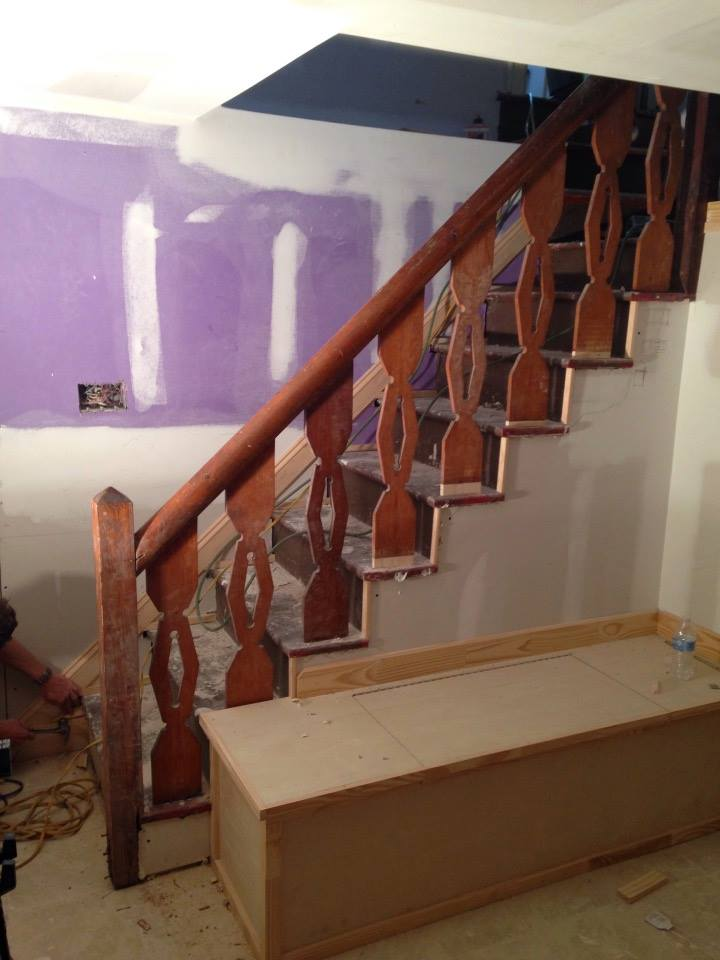 The home's original basement ballustrade would have been lost had we moved the kitchen wall.