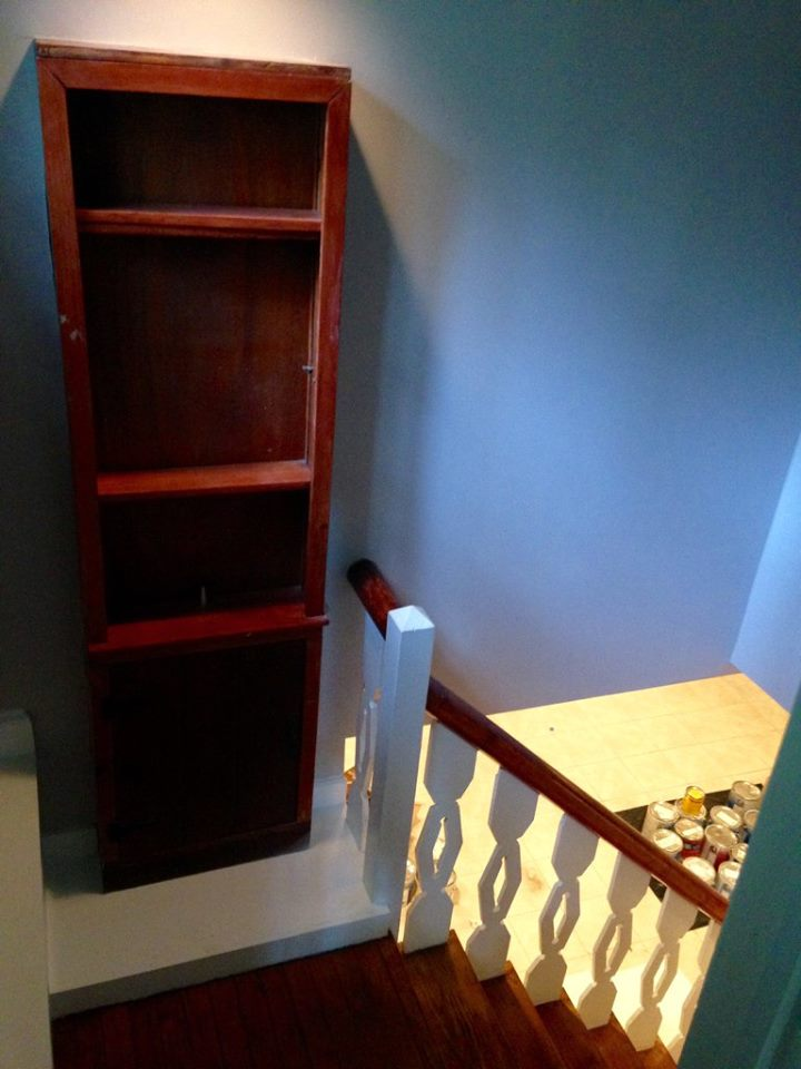 The old bookcase found a new home at the top of the basement stairs.