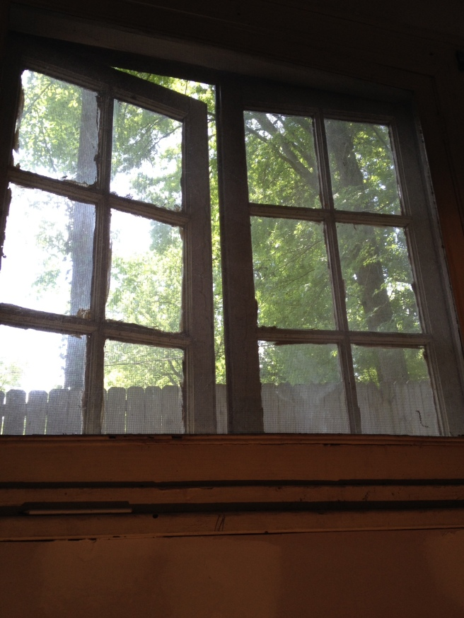 The original windows at the basement landing.